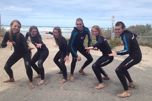 surfers posing with their wetsuit hired in Surf and Sun