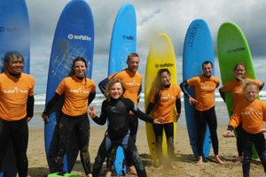 surfers posing with surf boards for surf lessons australia