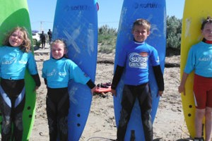 surfboards posing for surf lessons South Australia