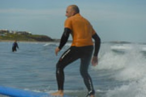 man learning how to surf in surf school south Australia